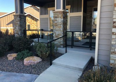 Residential-glass-railing-and-gate-with-black-powder-coat-finish
